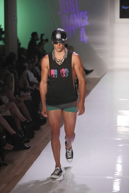 A model walks the runway at the Tumbler And Tipsy By Michael Kuluva wearing a helmet and eyewear by Stevie Boi, a designer from Baltimore.
