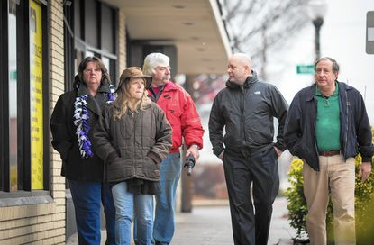Catonsville developer Steve Whalen, right, is joined by fellow members of the Arbutus Commercial Revitalization Group, from left, Bobbie Foster, Debbie SeBour, Terry Nolan and Tim McIntre on a walk along East Drive in downtown Arbutus. Whalen plans to develop a nearby property to include a large commercial building and a restaurant.