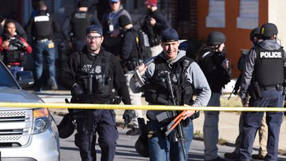 Baltimore Police and ATF agents work inside a cordoned off area in West Baltimore in the days following the November fatal shooting of Detective Sean Suiter.