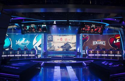 A screen, center, shows a video game competition between teams Luminosity, left, and Renegades, right, in the ELeague arena at Turner Studios, on May 24, in Atlanta. Video gaming makes another attempt to go mainstream, this time with the ELeague, a joint venture between Turner Sports and IMG that kicks off in a high-tech studio near downtown Atlanta. Twenty-four teams are playing Counter-Strike: Global Offensive for $1.4 million in prize money, but the stakes are much higher for those who think a bunch of headset-wearing guys sitting at computer consoles can someday be viewed as a legitimate sport.