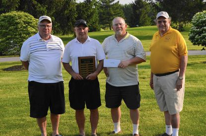 The winning foursome from the Freedom District Lions Club who won a separate contest of low score by a Lions Club team at last year's tournament.