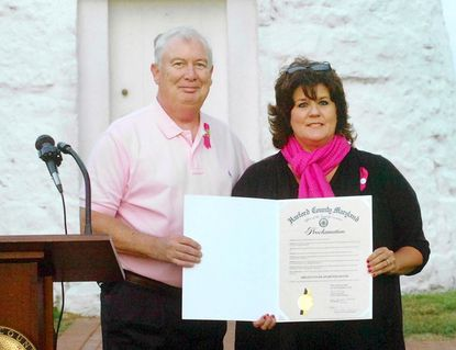 County Executive David Craig presents a proclamation recognizing October as Breast Cancer Awareness Month in Harford County to Kim Spence, who is coordinator of the county government's breast cancer awareness program, during the ceremonial pink lighting of Concord Point Lighthouse in Havre de Grace on Sept. 27.