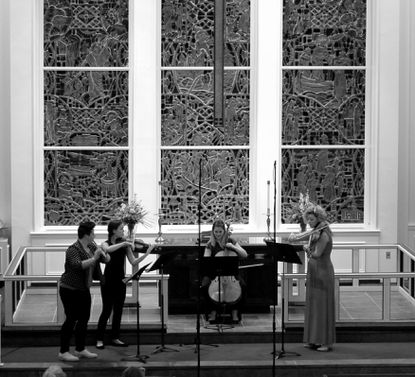 (From left to right) Flutist Isabel Gleicher, violinist Molly Germer, cellist Madeline Fayette and violist Alicia Valoti perform at the Calvary United Methodist Church as part of the Annapolis Chamber Music Festival.