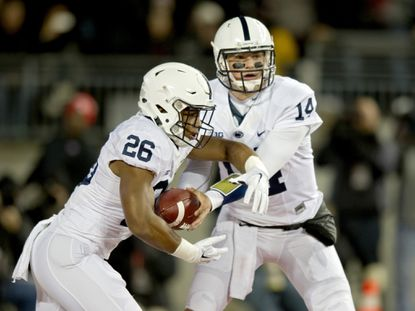 Penn State quarterback Christian Hackenberg (14) hands off to running back Saquon Barkley (26) during the first half at Ohio Stadium in Columbus, Ohio, on Saturday, Oct. 17, 2015.