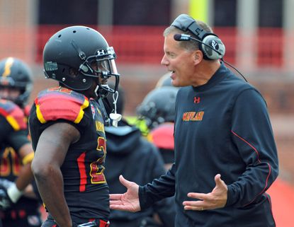 Maryland coach Randy Edsall talks with Cameron Chism after Chism's first quarter pass interference penalty resulted in a West Virginia touchdown.