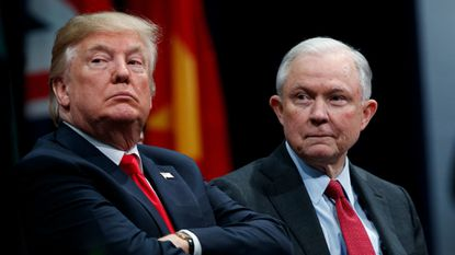 President Donald Trump sits with Attorney General Jeff Sessions during the FBI National Academy graduation ceremony in Quantico, Va. last month.
