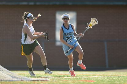 River Hill sophomore Gabby Hamburger (shown here during a game against Wilde Lake on April 12) led the Hawks with five goals and one assist against Oakdale and Liberty at the Friendship Tournament at Mount de Sales Academy on Saturday, April 16.