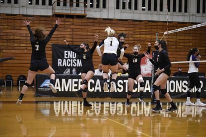 The UMBC volleyball team celebrates winning the America East Conference title with a five-set victory over Albany.