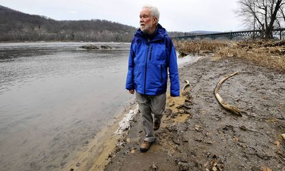 Lee Baihly stands near the Potomac River at Potoma Wayside where his River and Trail Outfitters has access to the river.