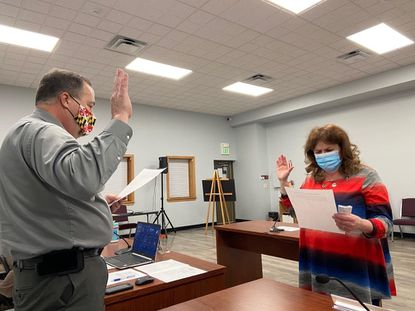 New Windsor Mayor Neal Roop swears in new Town Council member, Sharon Gribbin-Lindemon at a Feb. 16 town work session.