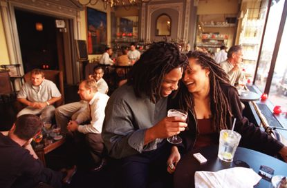 A photograph of the Brewer's Art's upstairs bar from Oct. 19, 2000. Robert Kenlaw (front-left) and Niela Magwood enjoy drinks by the window. The Brewer's Art celebrates its 20th anniversary in October with a party.