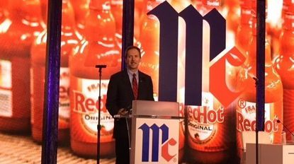 Lawrence E. Kurzius, CEO of McCormick & Co., speaks to shareholders during the spice maker's annual meeting Wednesday.