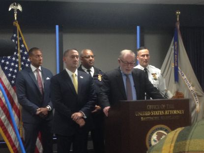 Acting Maryland U.S. Attorney Stephen Schenning, flanked by law enforcement, announces another drug crew takedown.