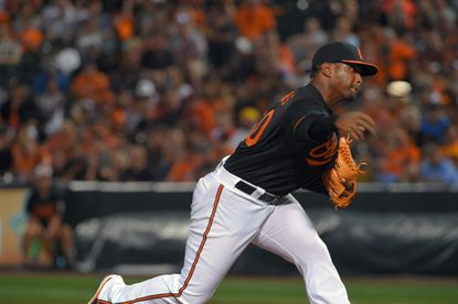 Orioles relief pitcher Mychal Givens uncorks a pitch against the Oakland Athletics at Camden Yards.