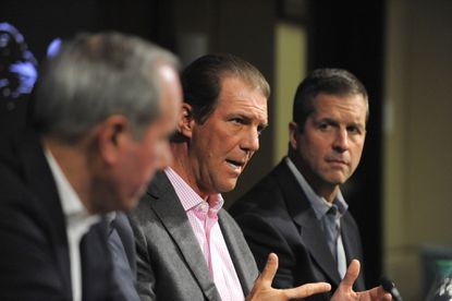 "Left to right, ravens president Dick Cass, owner Steve Bisciotti and coach John Harbaugh meet with the media at last year's ""State of the Ravens"" address on Feb. 24, 2015."