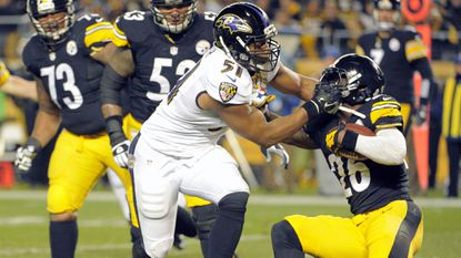 Ravens linebacker Daryl Smith, left, tackles Pittsburgh Steelers running back Le'Veon Bell during the game between the two teams at Heinz Field in November.