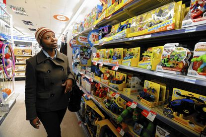 "Keysha Chambers, of Parkville, shops for toys such as the ""imaginext"" dragon at the Kmart in North Plaza Mall for her 3-year-old son for Christmas. Some toys of the past like Furby are making a comeback this holiday shopping season."