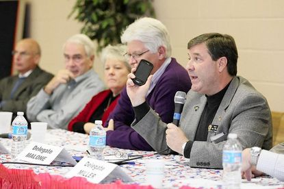 Del. James Malone talks about cell phone safety during a League of Women Voters of Howard County legislative luncheon Jan. 5 in Ellicott City. To Malone's right are Del. Steven DeBoy, Del. Gail Bates, state Sen. Jim Robey and state Sen Allan Kittleman.