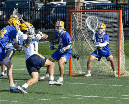St. Paul's Jake Bair (1) tries to put a shot on goal as Loyola Blakefield goalie Jack Webb defends during a boys lacrosse game at St. Paul's School on Tuesday, April 13, 2021.