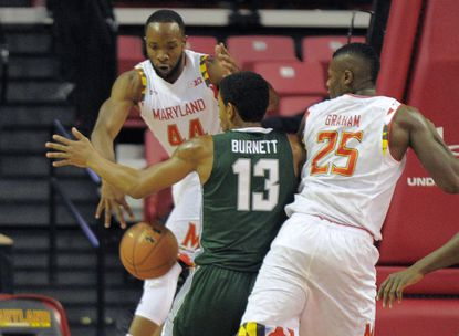 Dez Wells (44), Jon Graham and the Terps have looked better overall on defense this season.