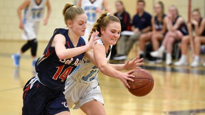 In action from a February meeting, Bel Air's Autumn Dougherty left, and C. Milton Wright's Taylor Marchetti battle for control of the ball. Tuesday night it was Marchetti's 19 points that led the Mustangs to a win.