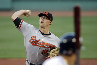 Baltimore Orioles starting pitcher Tyler Wilson delivers to the Boston Red Sox in the first inning of a baseball game at Fenway Park on Thursday, June 16, 2016, in Boston. (AP Photo/Elise Amendola)