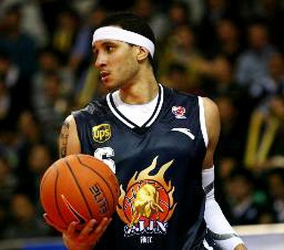 Former South Carroll basketball standout Josh Boone is shown during his time playing professional ball in China.