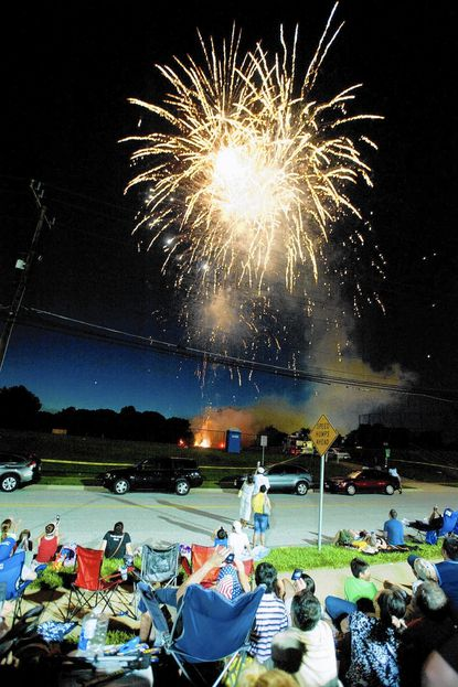 The Loch Raven Village Associates is asking for donations from individuals and surrounding communities to help with costs of the July 4 fireworks display it puts on every year. Here, people watch from the grounds of Loch Raven Technical Academy.
