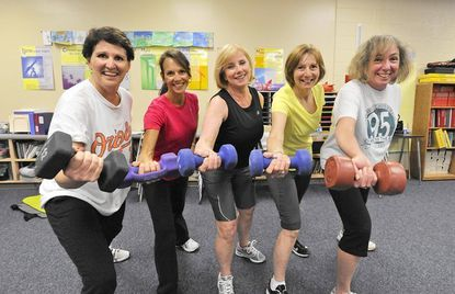 Four Clarksville Middle School teachers and one guidance counselor work out 4 to 5 times a week, after school is over, for about an hour. From left, Emily Savopoulos, Cathi McNees, Linda Pieplow, Arlene Katz (the guidance counselor), and Rhonda Nowacek do a cardiovascular workout using a video.