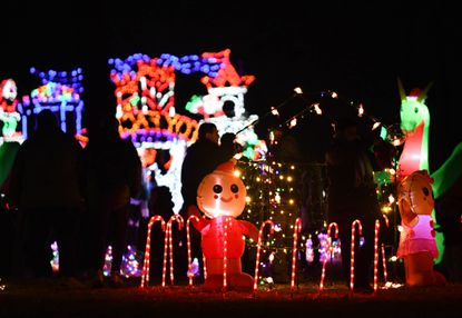 People walk around Ice & Fire, a winter wonderland festival at Symphony Woods, to take pictures of the light displays, roast marshmallows over firepits and meet Santa last December.