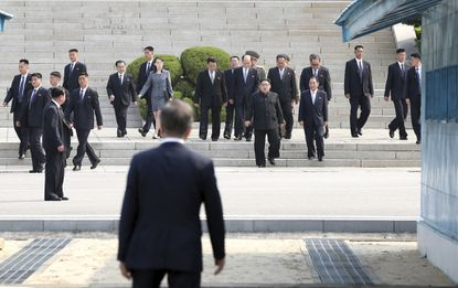 North Korean leader Kim Jong Un, center, walks toward South Korean President Moon Jae-in at the border village of Panmunjom, South Korea on April 27, 2018.