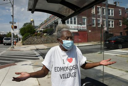 Cynthia Shaw, president of the Lyndhurst Community Association, worked for 14 years to bring the Red Line light rail transit system to the Baltimore area. Maryland Gov. Larry Hogan canceled the project five years ago. Here, she stands at a bus stop near where the light rail stop would have been, at Edmondson Avenue and Allendale Street. Aug. 28, 2020