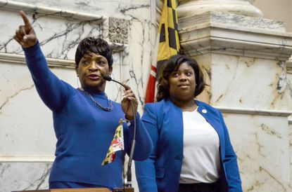 Maryland House of Delegates Speaker Adrienne A. Jones, left, points out Tuesday to new Del. Chanel Branch of Baltimore where her name is on the voting board in the chamber, right above that of her father, Del. Talmadge Branch. Chanel Branch was sworn in to fill a vacant seat.