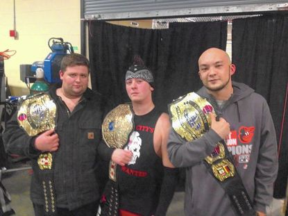 Liberty grads return to school as professional wrestling champs