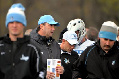 Head coach Dave Pietramala (second from left in blue cap) returned to coach Johns Hopkins to a 13-12 win overOhio State in men's lacrosse at Homewood Field on Saturday.