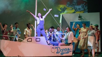 """Alison Brodbeck, center, performs with the cast of """"Mamma Mia!"""" at Howard County High School."""