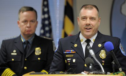 Anne Arundel Fire Chief Michael E. Cox Jr., right, and Police Chief Kevin Davis, left -- shown in a photo from a press conference earlier this month -- appeared at Friday's meeting of the county's Delegation to Annapolis to discuss minority hiring.