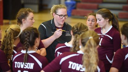Towson volleyball coach Emily Berman talks with her players between games at a home match with Hereford in 2015.