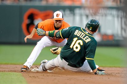 Billy Butler of the Oakland Athletics is tagged out at second base by Orioles shortstop J.J. Hardy in the third inning at Camden Yards on Aug. 15, 2015 in Baltimore.