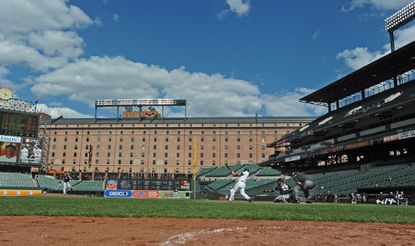 Everth Cabrera bats against the White Sox in the eighth inning of the Orioles' 8-2 win at Camden Yards. The game was closed to the public. It was the first time a major league game had been played without a paying crowd, according to MLB historian John Thorn.