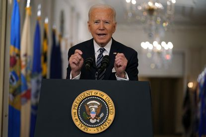 President Joe Biden leans forward on the lectern as he speaks about the COVID-19 pandemic during a prime-time address from the East Room of the White House on Thursday. (AP Photo/Andrew Harnik)