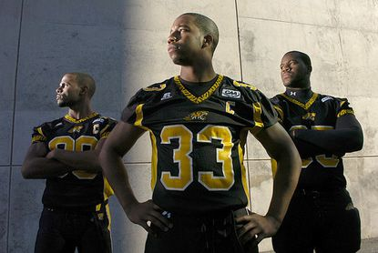 Wide receiver Demetrius Harrison, free safety Kenny Scott and defensive end Richard Lee (left to right) came to Towson University without a scholarship and went on to earn one on the field. Since 2003, the Tigers have had four walk-ons who became co-captains.