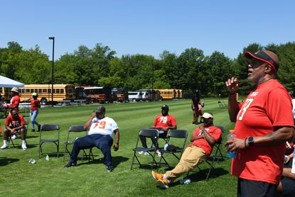 Martin McNair, right, father of Jordan McNair and founder of The Jordan McNair Foundation, speaks to a group of parents and coaches at the foundation's health & wellness sports clinic which was held at McDonogh School today. June 5, 2021