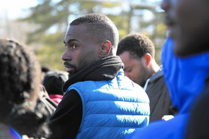 DeRay Mckesson looks over a crowd of students at Mount Hebron High School in Ellicott City who walked out of class Tuesday morning to raise awareness about racism in Howard County schools.