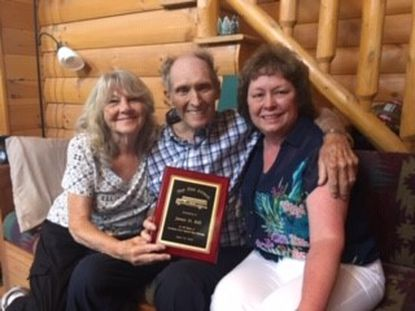 Linda Rill and Jim Rill, left, bus contractors, smile with Dianne Grote, president of the Carroll County School Bus Contractors Association as she presents Jim with an award for 53 years of accident-free driving.