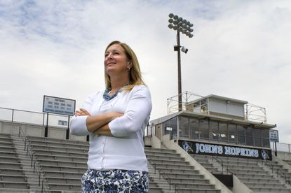 Johns Hopkins women's lacrosse head coach Janine Tucker poses for a photo at Homewood field. The team announced it's affiliation with the Big Ten sports conference Wednesday Afternoon.
