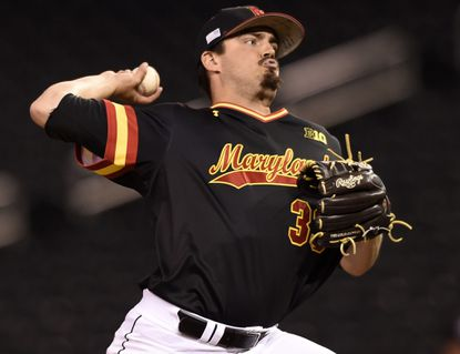 Maryland closer Kevin Mooney delivers against Illinois during the ninth inning of a second-round NCAA Big Ten tournament college baseball game on May 21 in Minneapolis.