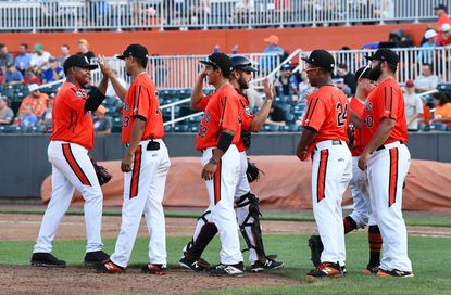 Aberdeen teammates give each other a round of high fives as they leave the field after a win in Friday night's first game of the double header against Connecticut at Leidos Field at Ripken Stadium.