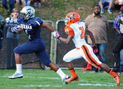Gilman's Troy Vincent Jr., left, runs away from McDonogh's Nihgel Scott for a touchdown in the first quarter.