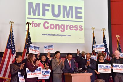 Supporters gathered around former U.S. Rep. Kweisi Mfume, at the podium, for his Nov. 4, 2019, announcement in Baltimore that he is running for his former seat in the 7th Congressional District. At his right is his wife, Tiffany Mfume, and at his left in front is Larry Gibson.